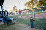 Trey at watches a Little League Baseball game at Freedom Park